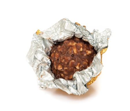 Chocolate balls with almond  in a gold foil paper. Stock Photo - 19054755