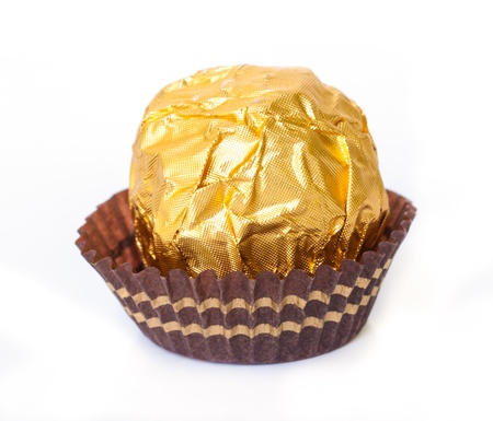 Chocolate ball with almond  in a gold foil paper. Stock Photo - 19054762