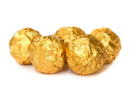 Group of Chocolate balls with almond  in a gold foil paper. photo