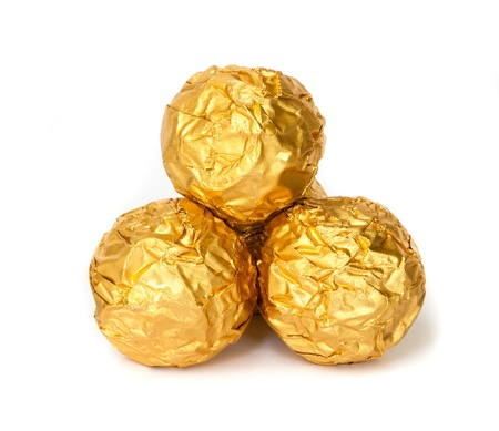 Group of Chocolate balls with almond  in a gold foil paper. Stock Photo - 19054758