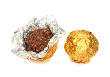 Chocolate balls with almond  in a gold foil paper. photo