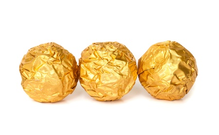 Tree Chocolate balls with almond  in a gold foil paper. photo