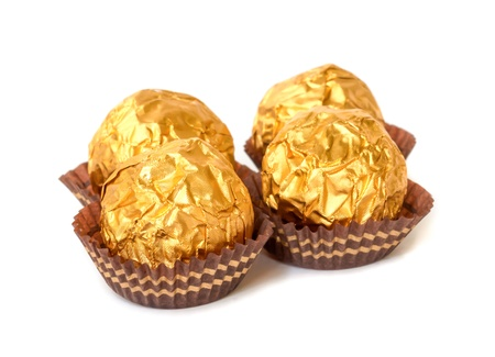 Chocolate balls with almond  in a gold foil paper. Stock Photo - 19054745