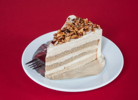 Coffee Cake with almond nut on the red  Tablecloth. photo
