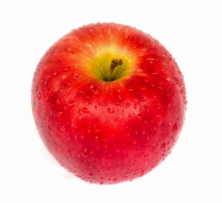 Fresh red apple with a dew on white background. photo