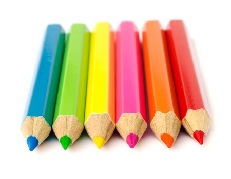 close up of colour pencils isolated on white background .