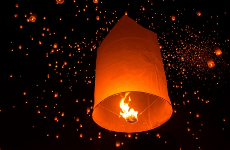 newyear night: Floating lantern in Yee Peng festival, Buddhist floating lanterns to the Buddha  in Sansai district, Chiang Mai, Thailand. Stock Photo