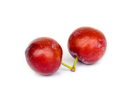 Ripe plums isolated on white background . photo