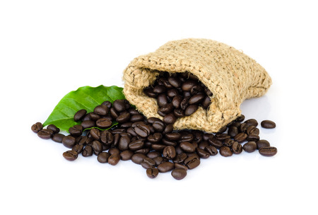 roasted coffee beans in a sack isolated on white background. photo