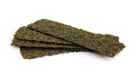 Piece of roasted seaweed snack on white background.