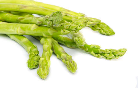 Fresh green asparagus on white background. photo