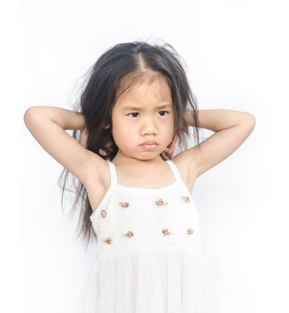 lugubrious: Portrait of  unhappy little girl  on a white background.