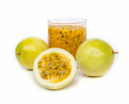 Ripe passion fruit with passion fruit juice  isolated on white background. photo