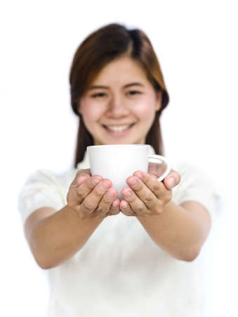 Beautiful asian teen drinking a cup of coffee. photo