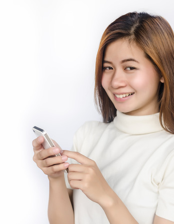 Portrait of Beautiful asian woman using smart phone against white background. photo