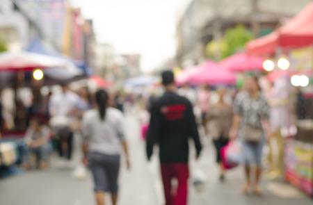 sidewalk sale: Abstract blurred people walking in walking street shopping centre .