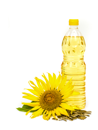 Bottle of sunflower oil with sunflower isolated on white background. Banque d'images