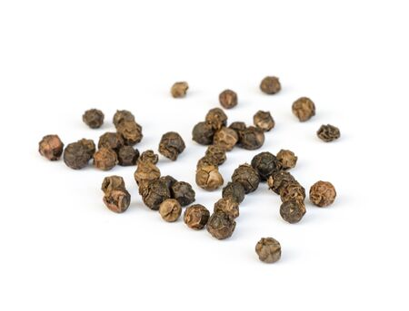piperine: Dry Black pepper isolated on white background .