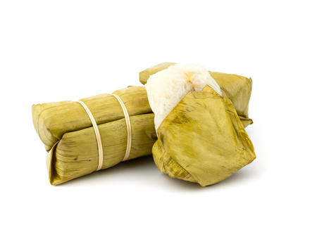 Thai dessert, Khao Tom Mad, steamed sticky rice with banana isolated on white.