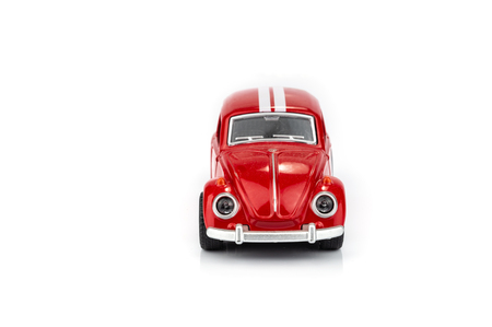 red toy car isolated on white background.