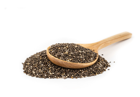 Healthy Chia seeds in a wooden spoon isolated on white.