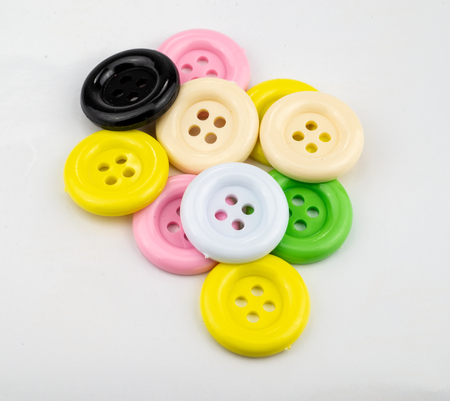 Colorful sewing buttons isolated on white background.