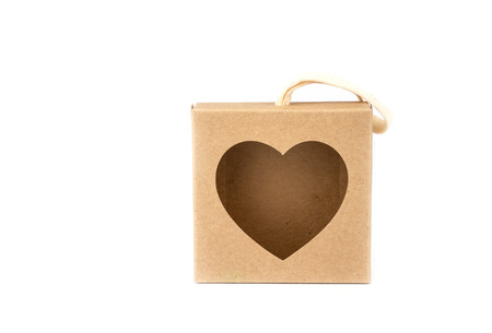 brown paper box with Heart shape window on white background. Reklamní fotografie