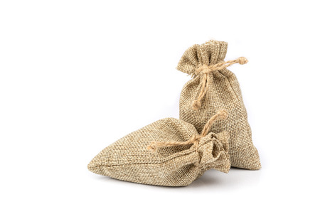 Burlap gift sack isolated on white background.