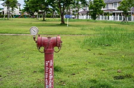red  fire hydrant sits in a freshly cut grass field.