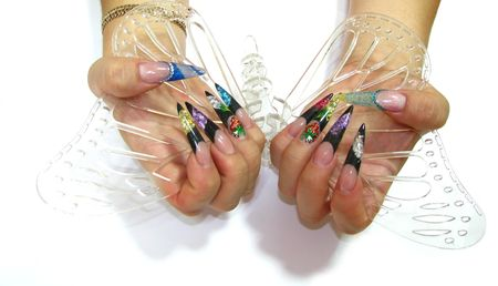 Close-up of hands with gel nails