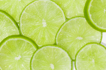 Natural green lime slices background