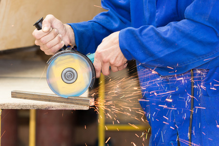 cutting metal: Cutting metal tube by grinder process Stock Photo