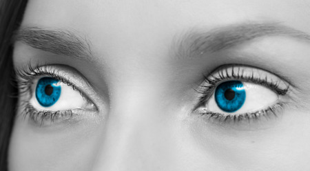 Isolated close-up of nice blue woman eyes. Stock Photo
