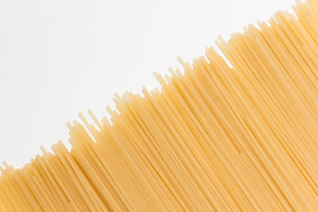 lie: Uncooked spaghetti lie on a diagonal direction Stock Photo