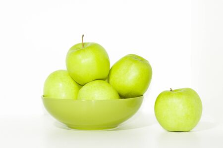 green apples: Green plate of fresh green apples isolated on white
