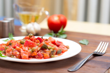 Fresh vegetable stew on wooden background Stock Photo