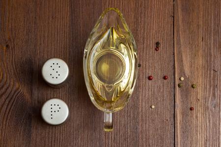 Olive oil, salt and prpper on wooden table
