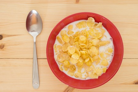 A bowl of Corn flakes with milk.