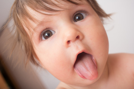 Cute baby showing tongue