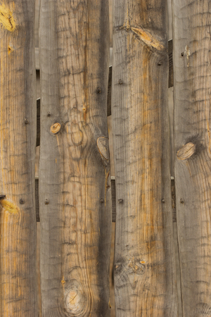 Wall maden of wooden planks as a texture or background
