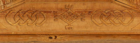 Details of a fine wood carving art. Carved wooden pattern texture