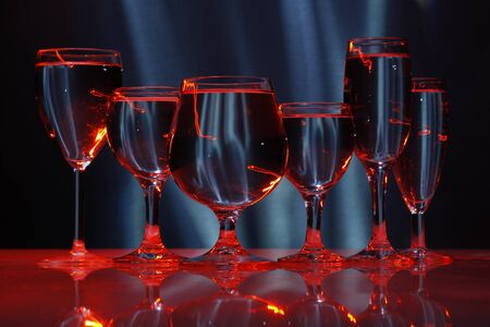 six glasses with water in light