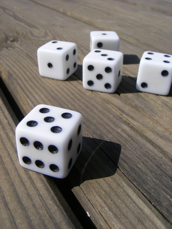 Dice game on old wooden table  photo