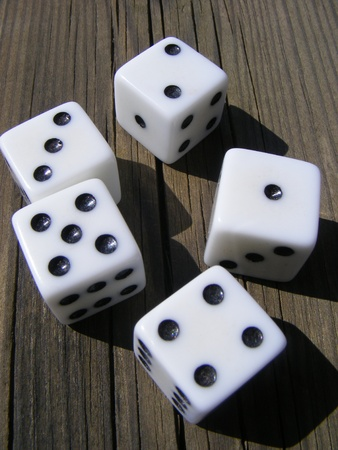 unpredictable: Dice game on old wooden table  Stock Photo