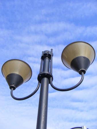 Modern street lamp over blue sky photo