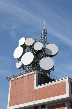 Communication tower building with antenna on top Stock Photo - 13619715