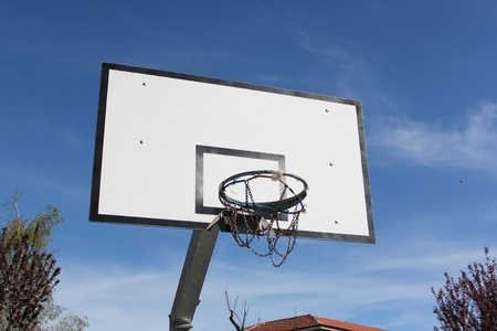 Outdoor basketball hoop in blue sky  Stock Photo - 13756257