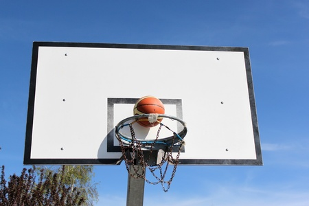 Outdoor basketball hoop in blue sky  Stock Photo - 13756254