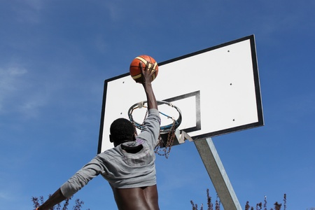 Outdoor basketball hoop in blue sky  photo