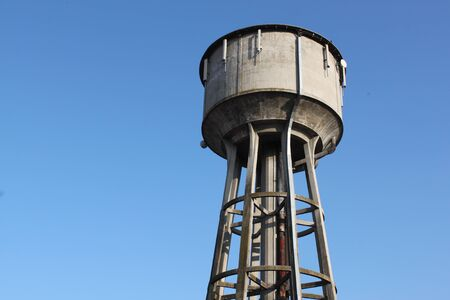 A white water tower against blue sky Stock Photo - 14257446
